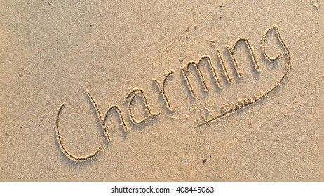 """written words """"Charming"""" on sand of beach"""