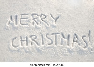 Written words Merry christmas  on a snow field, new year concept