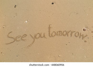 """written words """"See you tomorrow"""" on sand of beach"""
