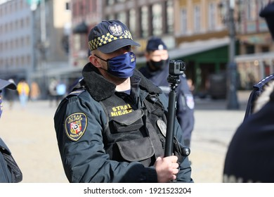 Wroclaw, Dolny Slask, Poland, 02.20.2021 The municipal police of Wrocław during a patrol in the city with a camera
