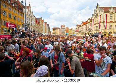 "WROCLAW - MAY 1: A crowd of people plays guitars in a Wroclaw market square at the ""Annual Thanks Jimi Guitar Festival"" in order to beat the Guinness Record on May 1, 2012 in Wroclaw, Poland."