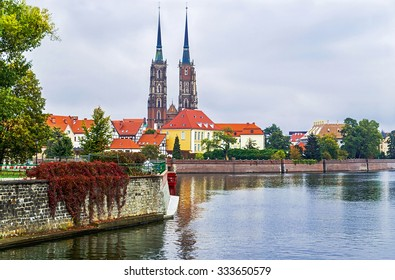 Wroclaw. Picturesque view of famous island Tumski with cathedral of St. John - oldest part of the city. Odra river. Poland. Travel, vacation, arhitectura concept. Copy space. Empty place for text.