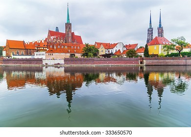 Wroclaw. Picturesque view of famous, old island Tumski with cathedral of St. John reflection in the Odra river. Poland. Travel, vacation, arhitectura concept. Copy space. Empty place for your text.
