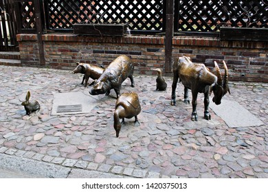 Wroclaw / Poland - 04/10/2018: Memorial to Slaughtered Animals - a reminder of the  animals who perished in the area throughout the centuries. Bronze goat, 2 pigs, duck, swine, rabbit.