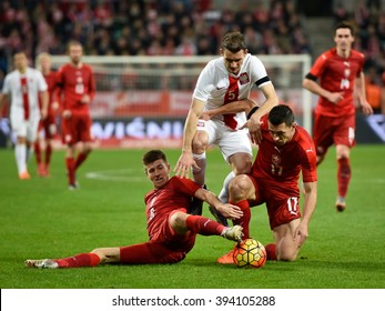 Wroclaw, Poland. 17th November, 2015. International Football friendly match: Poland v Czech Republic. In action Krzysztof Maczynski (5), Lukas Bartosak (L) and Marek Suchy (17).