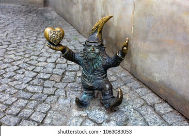 Wroclaw, Poland - 26 July, 2016: The Wroclaw Gnome holds the heart in his hand