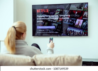 WROCLAW, POLAND - APRIL 03rd, 2018: Woman is using NEtflix application on her TV.Netflix is an american entertainment company specialized in streaming media.