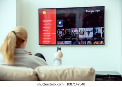 WROCLAW, POLAND - APRIL 03rd, 2018: Woman is using google play on her TV. Google Play is a digital distribution service operated and developed by Google.