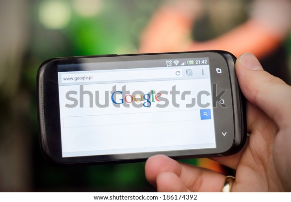 WROCLAW, POLAND - APRIL 05, 2014: Smartphone with Google search website