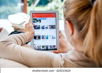 WROCLAW, POLAND- APRIL 10th, 2017:  Woman launches Youtube application on Lenovo tablet. YouTube is an American video-sharing website headquartered in San Bruno, California.