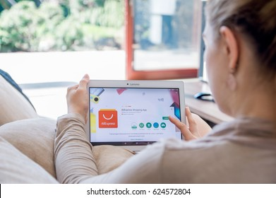 WROCLAW, POLAND- APRIL 10th, 2017:  Woman is installing Aliexpress application on Lenovo tablet. AliExpress.com is an online retail service made up of mostly small Chinese businesses