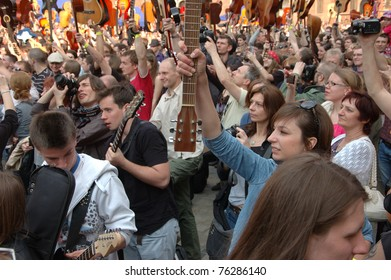 WROCLAW, POLAND - APRIL 30: Guitars World Guinness Record, 5601 participants gather in front of Wroclaw's Town Hall on April 30, 2011 to beat guitar mass participation record in Wroclaw, Poland.