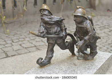 WROCLAW, POLAND - APRIL 6: Sculpture of gnome from fairy-tale made by Grzegorz Lagowski on the street on April 6th, 2014 in Wroclaw, Poland.