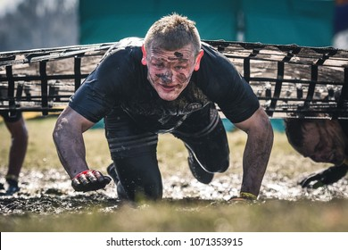 WROCLAW, POLAND - APRIL 7; 2018: Extreme running with obstacle RUNMAGEDDON. In the picture a runner on the Recruit route.