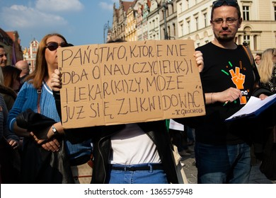 Wroclaw Poland - April 7, 2019: Strike teachers on the square near the Town Hall. The inscription on the transporant in Polish: States that do not care about teachers and doctors are doomed to death