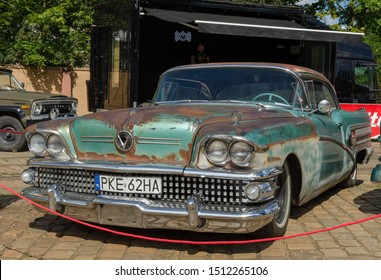 WROCLAW, POLAND - August 11, 2019: USA cars show, 1936 Buick Limited. Rusty car requiring renovation.