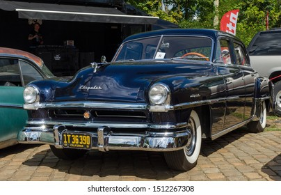 WROCLAW, POLAND - August 11, 2019: USA cars show, 1936 Buick Limited. Rusty car requiring renovation.1951 Chrysler Windsor DeLuxe Six-Passenger Sedan
