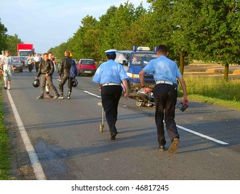 WROCLAW, POLAND - AUGUST 12: Policeman investigates a fatal motorbike accident on August 12, 2001 in Wroclaw, Poland