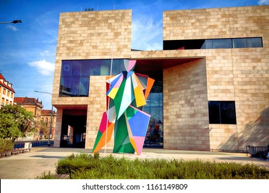 WROCLAW, POLAND - AUGUST 19, 2018: Capitol Music Theatre and a new Harlequin sculpture by Alessandro Mendini in Wroclaw, Poland.
