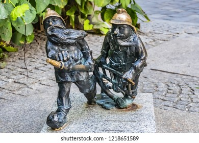 WROCLAW, POLAND - AUGUST 30, 2017: The small Wroclaw bronze gnome sculptures are the main tourist attraction and symbol of the city. Wroclaw has 350 gnome sculptures around the city.