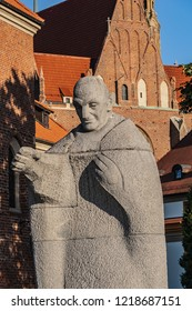 """WROCLAW, POLAND - AUGUST 30, 2017: Wroclaw Monument of Pope John XXIII (1968) at San Marcin Street. Title of one of his encyclicals - Pacem in terris (""""Peace on Earth"""") is carved on the pedestal."""