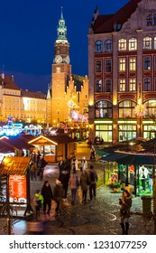 WROCLAW, POLAND - DEC 8, 2017: Christmas market on Market square (Rynek) in Wroclaw, Poland. One of Poland's best and largest Christmas markets, stretching across two sides of Wroclaw's market square