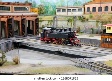 WROCLAW, POLAND - DECEMBER 12, 2018: The maquette of retro steam locomotive on a railway turntable or wheelhouse