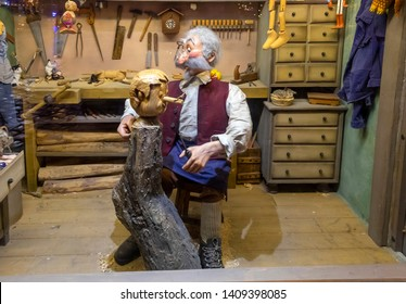 "WROCLAW, POLAND - DECEMBER 12, 2019: Installation ""Mister Geppetto carving Pinocchio"" at christmas market. Wroclaw, Poland"
