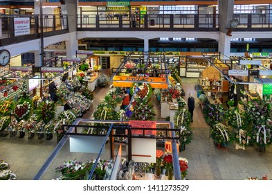 """WROCLAW, POLAND - DECEMBER 12, 2019: Flowers stores at Wroclaw Market Hall """"Hala Targowa"""" - central marketplace at Wroclaw. Poland"""