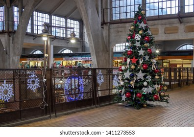 """WROCLAW, POLAND - DECEMBER 12, 2019: Christmas tree at Wroclaw Market Hall """"Hala Targowa"""" - central marketplace at Wroclaw. Poland"""