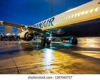 WROCLAW, POLAND - DECEMBER 14, 2018: Night passengers boarding to Ryanair airplane. Ryanair is a low-cost carrier based in Ireland