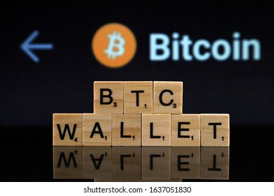 WROCLAW, POLAND - FEBRUARY 04, 2020: Words BTC WALLET made of small wooden letters. Bitcoin (BTC) wallets can either be digital apps or be hardware based.