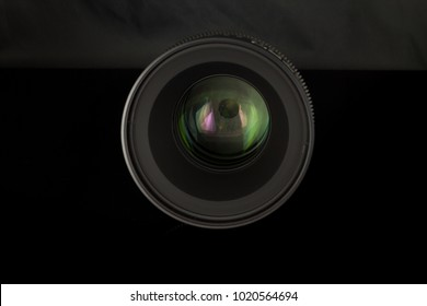 WROCLAW, POLAND - FEBRUARY 08, 2018 Professional Cinema Lens Xeen Samyang - camera lenses on the mirror black background -