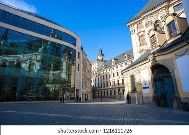 Wroclaw, Poland - February 2016:  Pedestrains walk along the street in front of the University of Wroclaw, main building.  Magnificent Baroque facade  with clear blue sky background