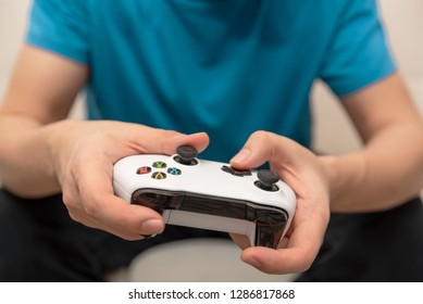 Wroclaw, Poland - JAN 08, 2019: Man holding Microsoft XBOX One X game pad. XBOX One X is most powerful generation video gaming console