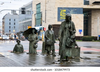 Wroclaw, Poland - January 07 2018: The Anonymous Pedestrians statue in Wroclaw, like a reminder that Poland was part of the communist past