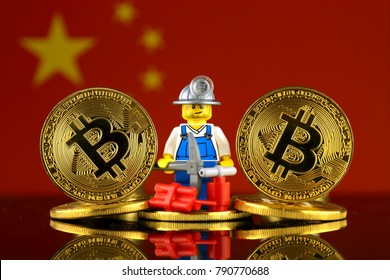 WROCLAW, POLAND - JANUARY 07, 2018: Physical version of Bitcoin, miner (as Lego figure) and China Flag. Studio shot.