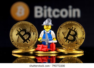 WROCLAW, POLAND - JANUARY 07, 2018: Physical version of Bitcoin and miner (as Lego figure). Studio shot.
