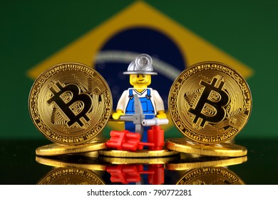WROCLAW, POLAND - JANUARY 07, 2018: Physical version of Bitcoin, miner (as Lego figure) and Brazil Flag. Studio shot.