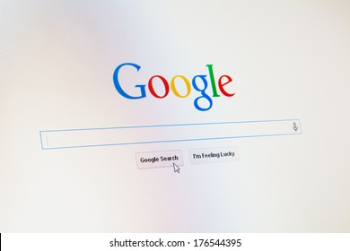 WROCLAW, POLAND - JANUARY 10, 2014: Google.com homepage with a cursor on the search button