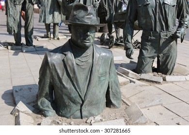 WROCLAW, POLAND - JULY 06, 2015: Detail of the monument of an anonymous passerby. The monument is located in the busy section of Wroclaw the crossroads of Pilsudskiego and Swidnicka streets.