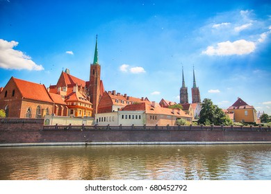 WROCLAW, POLAND - JULY 18, 2017: Wroclaw Old Town. Cathedral Island (Ostrow Tumski) is the oldest part of the city. Odra River, boats and historic buildings on a summer day.