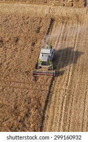 Wroclaw, Poland - July 22, 2015: aerial view of the combine on harvest field in Poland.