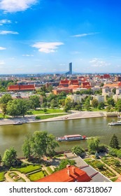 WROCLAW, POLAND - JULY 29, 2017: Aerial view of Wroclaw. Old Town and Cathedral Island (Ostrow Tumski) is the oldest part of the city. Odra River, boats and historic buildings on a summer day.