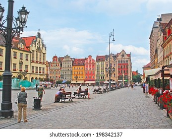 WROCLAW, POLAND - JULY 5, 2010: Best place to feel medieval spirit is Marketplace, here are old mansions, Old and New Town Halls, cafes and bars for relax and try local beer, on July 5 in Wroclaw.