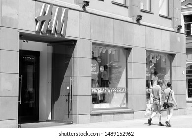 WROCLAW, POLAND - JULY 6, 2014: People shop at H&M fashion store in Wroclaw. H&M is an international fashion retail corp known for its fast fashion approach. Founded in 1947, it employs 87,000 people.
