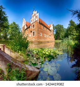 WROCLAW, POLAND - JUNE 11, 2019: The Renaissance Water Castle in Wojnowice near Wroclaw, Poland. Currently, there is a hotel and restaurant here.