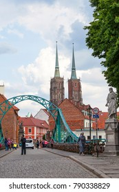 WROCLAW - POLAND, JUNE 12, 2017: Wroclaw Cathedral (Cathedral of St. John the Baptist), gothic style 13th century church and Tumski Bridge on Ostrow Tumski Island. It is the oldest part of the city