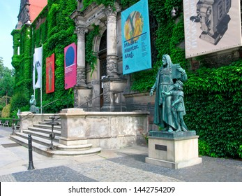 Wroclaw, Poland - June 15, 2019: Sculpture of Albrecht Durer on front of entrance to the National Museum in Wroclaw. Durer is the German painter and graphic artist of the Western European Renaissance.