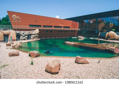 """WROCLAW, POLAND - June 23, 2016: Facade of the modern zoo stylized to Africa with artificial in the foreground. """"Afrikarium"""" in Wroclaw, Poland"""